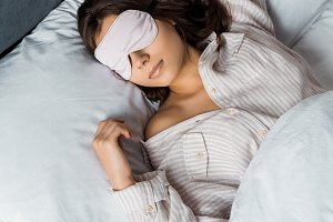 attractive young woman sleeping in e