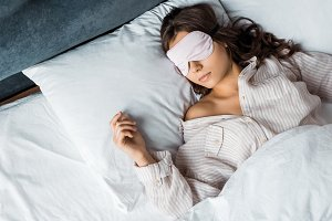 young brunette woman sleeping in eye