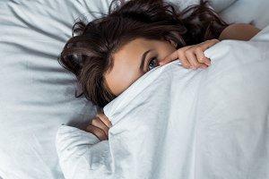 attractive girl hiding under white b