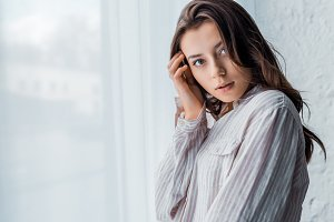 young tender woman in pajamas standi