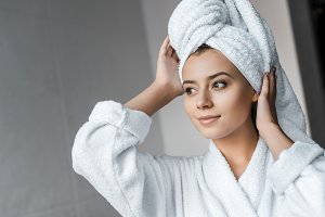 smiling young woman in white bathrob