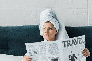 beautiful girl reading travel newspa