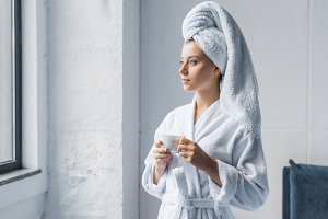 young woman in bathrobe and white to