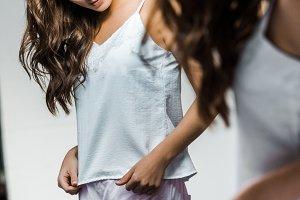 beautiful slim girl in pajamas looki
