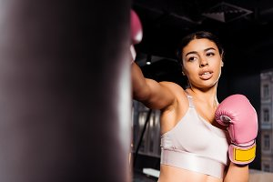 Attractive strong girl in pink boxin