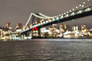 Blurred Manhattan bridge at night