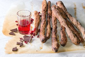 Grissini bread and red liqueur