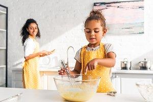 african american daughter preparing