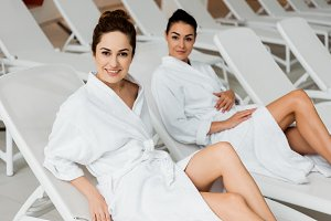 attractive young women in bathrobes