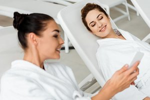smiling young women in bathrobes usi