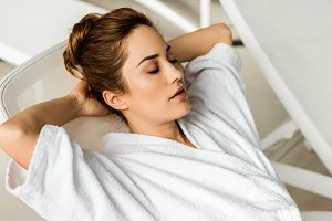 beautiful young woman in bathrobe ly