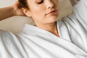 attractive young woman in bathrobe l