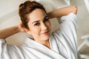 beautiful young woman in bathrobe ly
