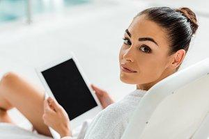 beautiful woman holding digital tabl