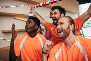 excited multicultural male football