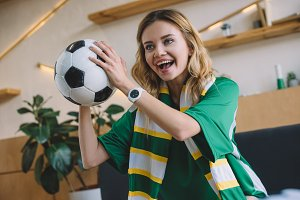 young excited female football fan in
