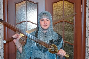A man dressed up in a knight's