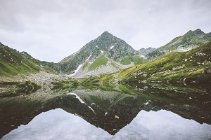 Lake in mountains mirror reflection