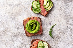 Healthy toasts with salmon and