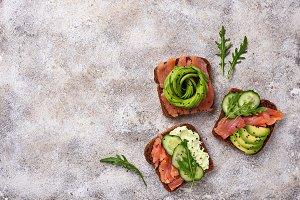 Avocado toast with salmon on rye