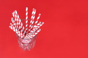 Red drinking straws in a glass