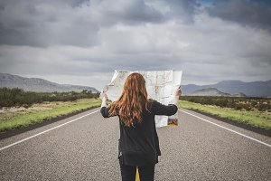 Woman on Road Trip Holding a Map