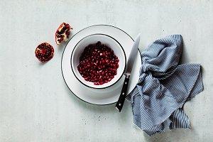pomegranate seeds in white enamel bo