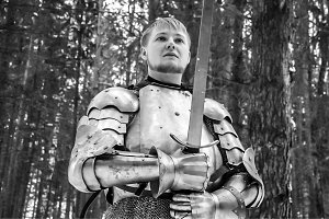 Knight in armor and with a sword in