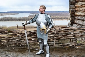 Knight in armor on the background of