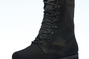 One black leather military shoe