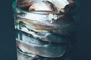 Pile of salted fish in glass isolate