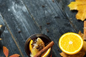 Mulled wine autumn drink on a wooden