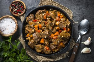 Beef stew with vegetables in iron