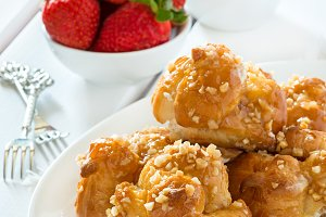 Profiteroles with nuts and strawberr