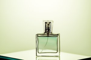 bottle of womans fragrance on glass