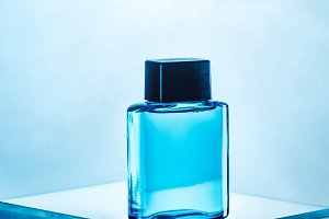 one blue bottle with mens perfume, o