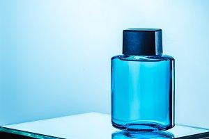 mens perfume in blue spray bottle, o