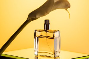 spray bottle of perfume and calla fl