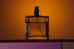 silhouette of luxury perfume in spra