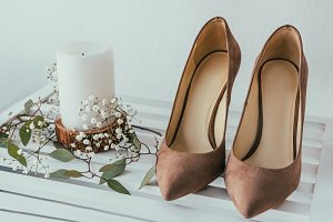 close up view of bridal shoes, candl