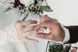partial view of groom wearing weddin