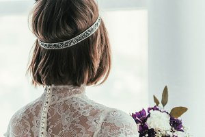 back view of bride in white dress wi