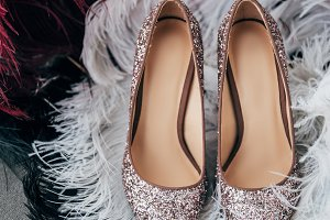 close up view of bridal shoes and de
