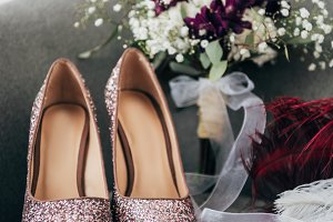 close up view of bridal shoes, groom