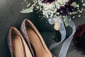 close up view of bridal shoes and bo