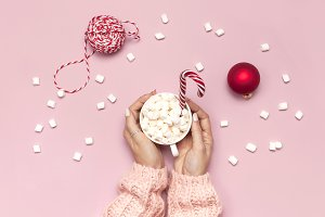 Female hands hold cup of marshmallow