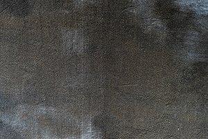 Dark textured surface abstract backg