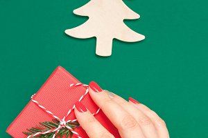 Christmas greeting card with woman h