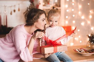 Mother with daughter open present