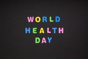 World Health Day writing on black pa